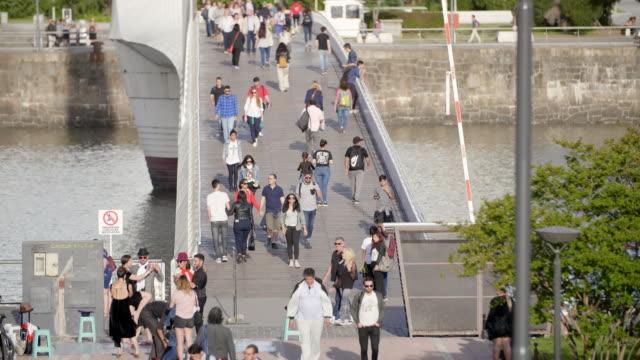 commuters on puente de la mujer - puente de la mujer stock videos & royalty-free footage