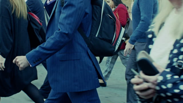 commuters on the go. side, tracking shot. - pavement stock videos & royalty-free footage