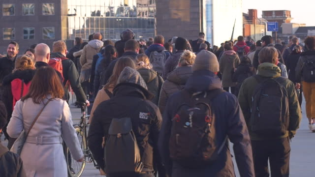 commuters on their way across london bridge. - brexit stock videos & royalty-free footage