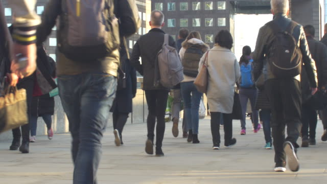 commuters on their way across london bridge. - city of london stock videos & royalty-free footage