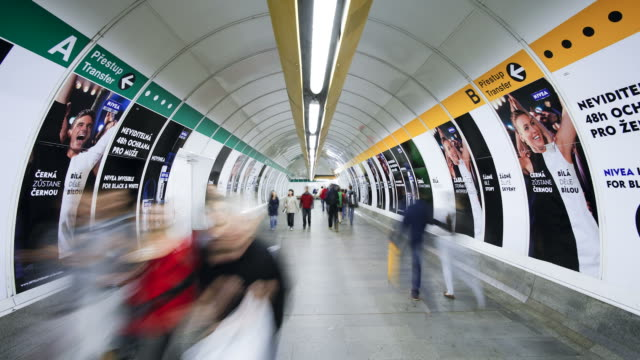 commuters pass through a tunnel part of an underground subway system. - poster stock videos & royalty-free footage