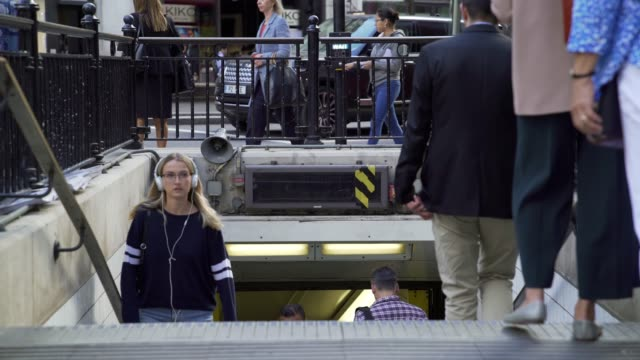 commuters passing by at london underground station - moving past stock videos & royalty-free footage