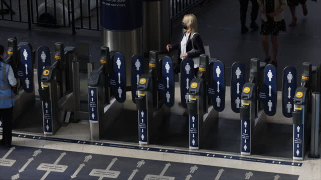 commuters passing turnstiles at waterloo station, in london, city of london, england, u.k., on monday, june 7, 2021. - public transport stock videos & royalty-free footage