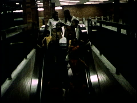 1975 montage commuters riding escalator at transit station and riding subway train / toronto, canada - 1975 stock videos & royalty-free footage