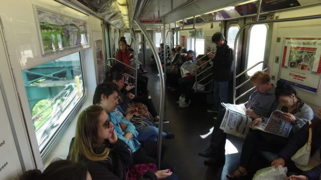 commuters riding new york city subway train - bahnreisender stock-videos und b-roll-filmmaterial