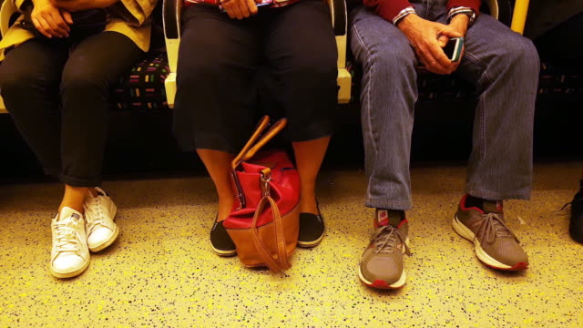 commuters riding the underground train - vehicle seat stock videos & royalty-free footage