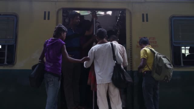 commuters rush to board a train at chennai central station in chennai india on monday july 20 commuters waiting for trains at chennai central station... - chennai stock videos & royalty-free footage
