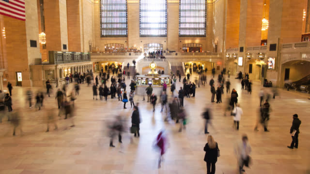 commuters speed through the concourse at grand central station in new york city. - grand central station manhattan stock videos & royalty-free footage
