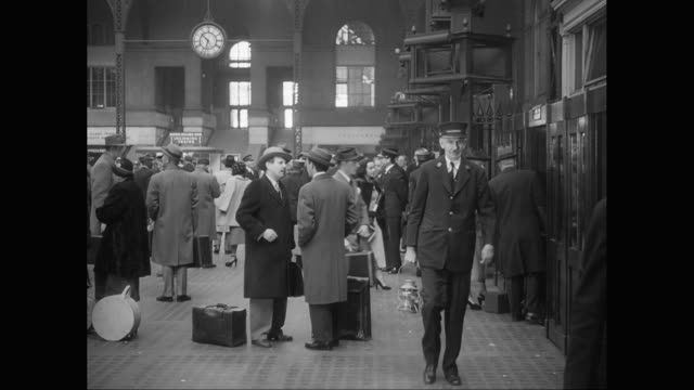 ws commuters standing and talking in penn station, new york city / united states - new york city penn station stock videos and b-roll footage