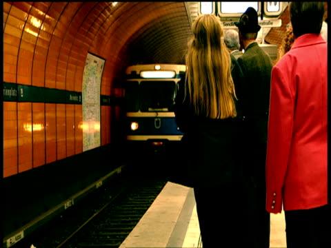 Commuters use escalators and cross busy foyer as U-Bahn trains zoom through tunnels below Marienplatz Munich
