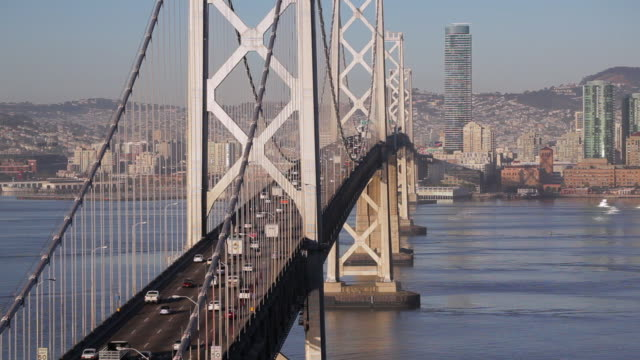 Commuters use the top deck of the Bay Bridge as they cross San Francisco Bay.