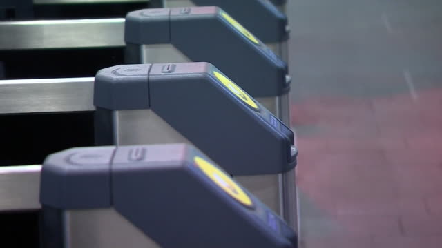 commuters using tickets oyster cards contactless bank cards and smartwatches to get through ticket barriers at london bridge train station - contactless payment stock videos & royalty-free footage