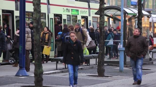 commuters wait for a tram in mannheim germany on tuesday jan 20 gvs of trams in mannheim - nordeuropäischer abstammung stock-videos und b-roll-filmmaterial