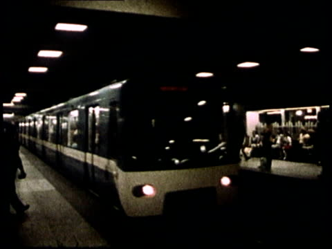 1975 montage commuters waiting at station and riding subway train / montreal, canada - モントリオール点の映像素材/bロール