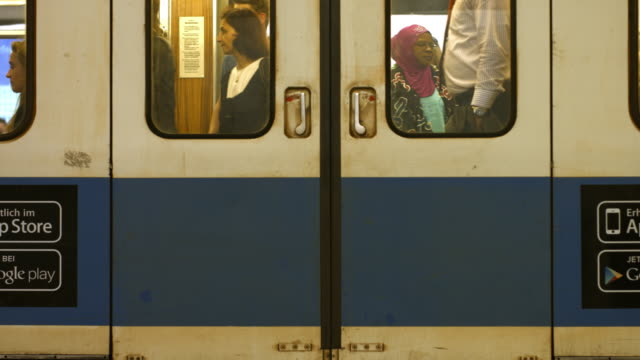 commuters waiting for subway train - passenger train stock-videos und b-roll-filmmaterial