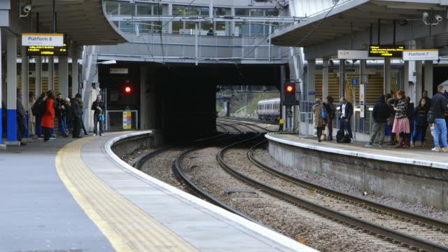 WS Commuters waiting on platform / Highbury and Islington Overground Station, London, England, United Kingdom