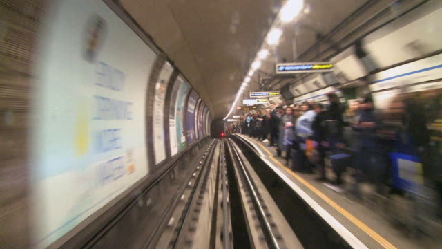 ws pov commuters waiting on platform / walthamstow underground station, london, england, united kingdom - tramway stock videos & royalty-free footage