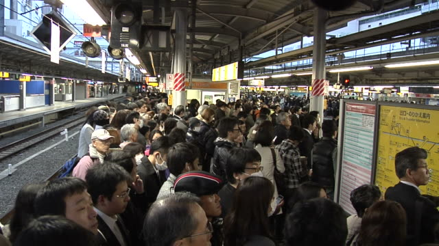 Commuters waiting on the JR Shinjuku Chuo Line Platform for a train home