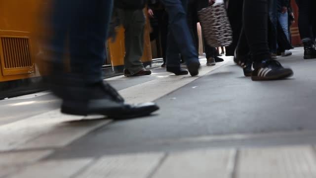 Commuters walk at a Berlin Subway Station