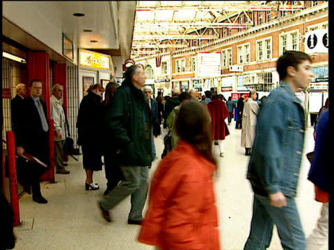 commuters walk into busy train station - 1997 stock videos and b-roll footage