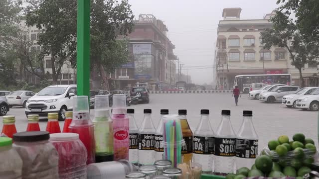 commuters walk on a pavement during a dust storm on may 01, 2021 in guwahati, india. - surface level stock videos & royalty-free footage