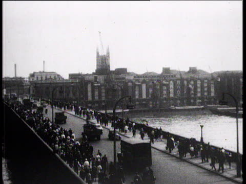 commuters walking along bridge on way home from work city of london 1957 - routine stock videos & royalty-free footage