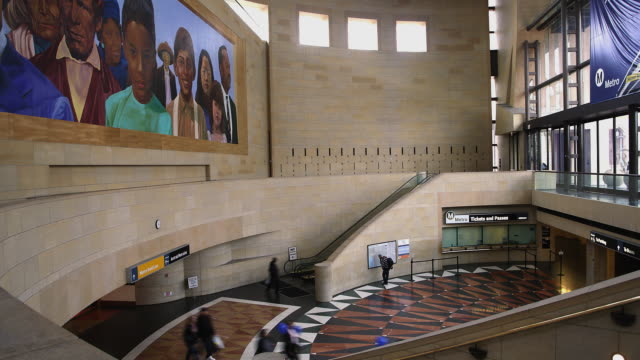 t/l ha ws commuters walking below mural in union station / los angeles, california, usa - union station los angeles stock videos & royalty-free footage