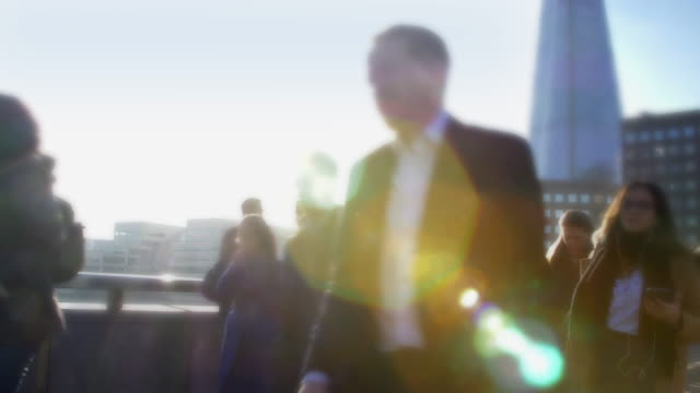 commuters walking, blue sky and sunlight. side view. - recruit stock videos & royalty-free footage