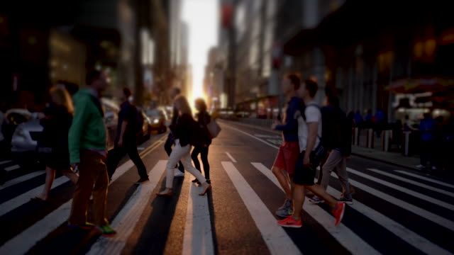 commuters walking in city business district. people crossing crowded street in new york