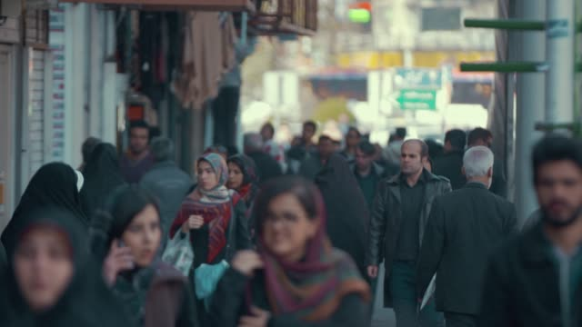 commuters walking in tehran - teheran video stock e b–roll