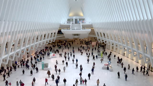 commuters walking inside the oculus building. - new stock videos & royalty-free footage