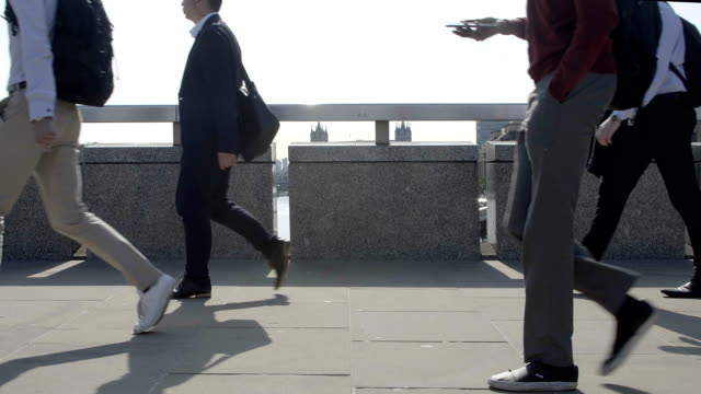 commuters walking, low angle. sm. - side view stock videos & royalty-free footage