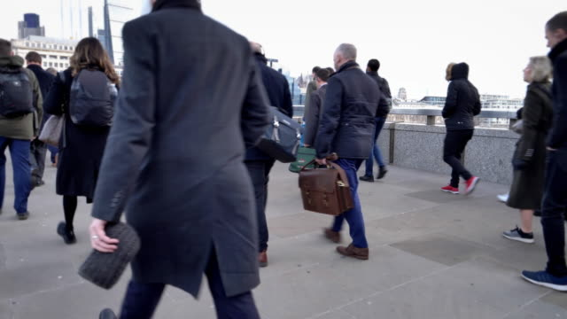 commuters walking, low angle view. rear/side view. realtime. - city of london stock videos & royalty-free footage