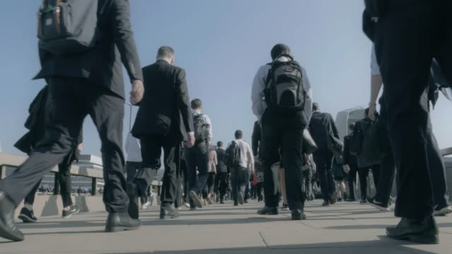 commuters walking, lower body wide angle. - physical activity stock videos & royalty-free footage