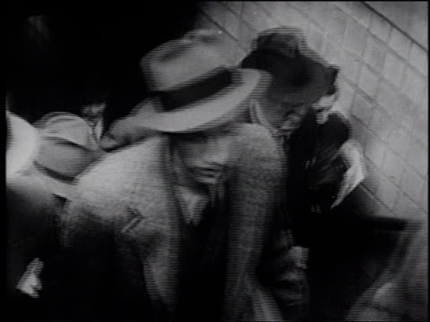 1945 montage commuters walking on a busy street / united states - frank capra video stock e b–roll