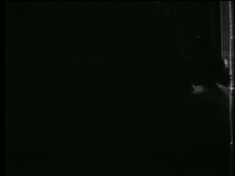 b/w 1939 commuters walking on busy street corner / nyc / documentary - manhattan stock videos & royalty-free footage