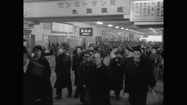 ws commuters walking on station during rush hour / japan - showa period stock videos & royalty-free footage