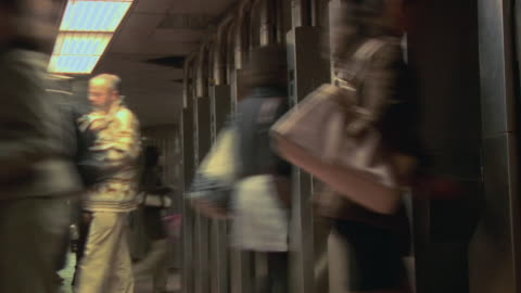 t/l ms commuters walking through subway station turnstile / new york, new york, usa - 2007 stock videos & royalty-free footage