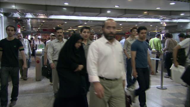 ms commuters walking through turnstiles in subway station, tehran, iran - tehran stock videos & royalty-free footage
