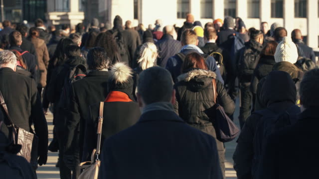 commuters walking to work. high angle view. slow motion. - crowd of people stock videos & royalty-free footage