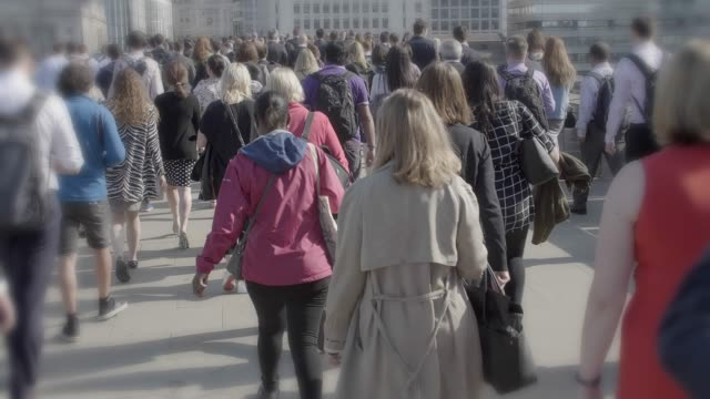 commuters walking to work in springtime. - time of day stock videos & royalty-free footage