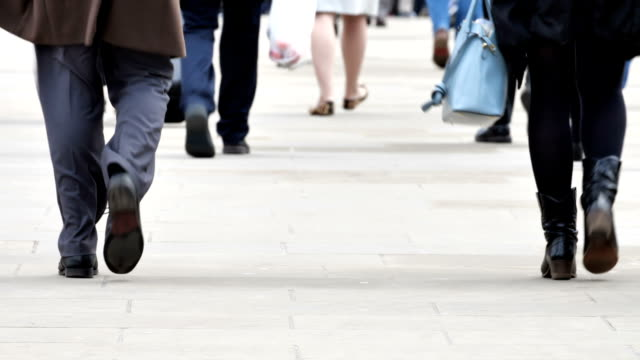 commuters walking to work. legs and feet low angle rear view. - low angle view stock videos & royalty-free footage