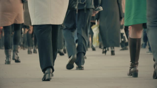 commuters walking to work. low age view. - sidewalk stock videos & royalty-free footage
