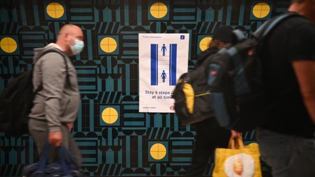 commuters wear face masks as they pass through vauxhall underground station on the first day of their mandatory use while travelling on public... - commuter stock videos & royalty-free footage