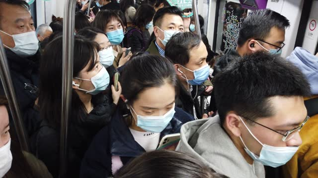 commuters wear protective masks as they walk at a subway station during rush hour on march 10, 2021 in beijing, china. - beijing stock videos & royalty-free footage