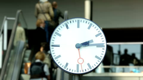 commuters with clock in the foreground - railroad station stock videos & royalty-free footage