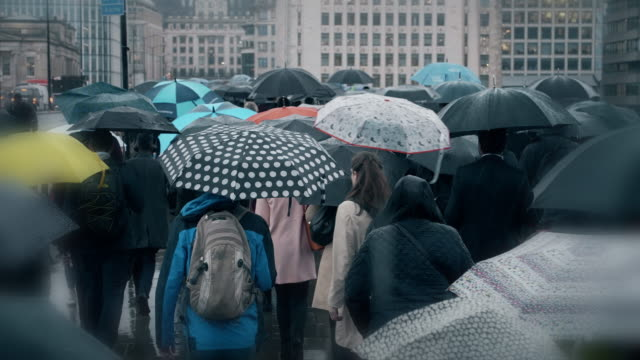commuters with umbrellas in the rain. sm. - rush hour stock videos & royalty-free footage
