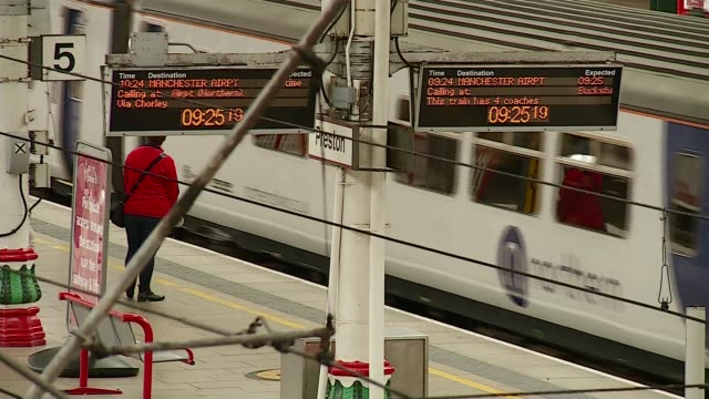 commuting chaos continues in the northwest despite timetable changes england lancashire preston int northern rail train into platform at preston... - northwest england stock videos and b-roll footage