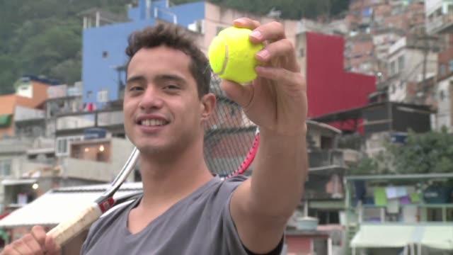 Como todo niño de favela Fabiano de Paula soñaba con ser un astro del fútbol De recogepelotas a tenista pro on August 13 2013 in Rio de Janeiro Brazil