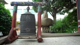 4K Compact bell outside the main hall door at Daegaksa Buddhist temple Busan